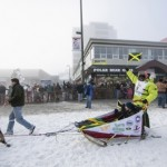 Jamaican musher Marshall greets the crowd while lining up for the ceremonial start to the Iditarod dog sled race in downtown Anchorage, Alaska